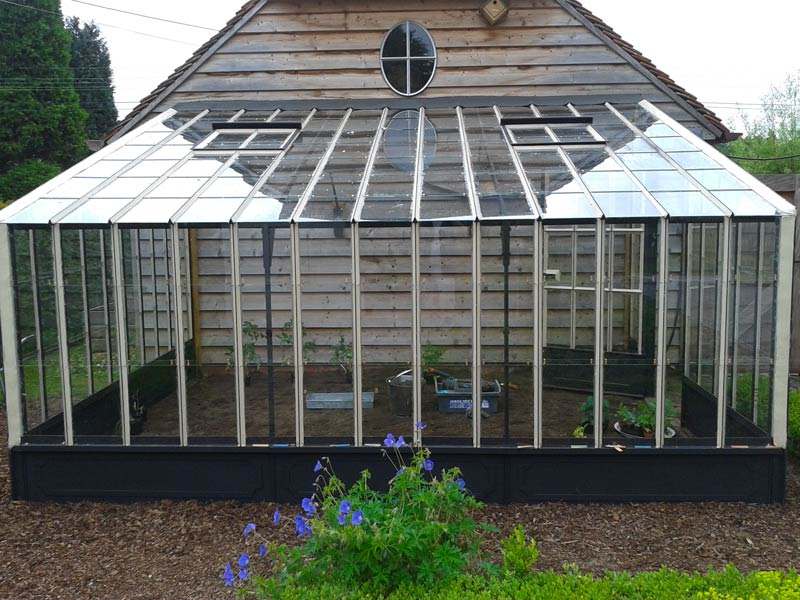 Wall Greenhouse In Wrought Iron Leaning Against Annex In