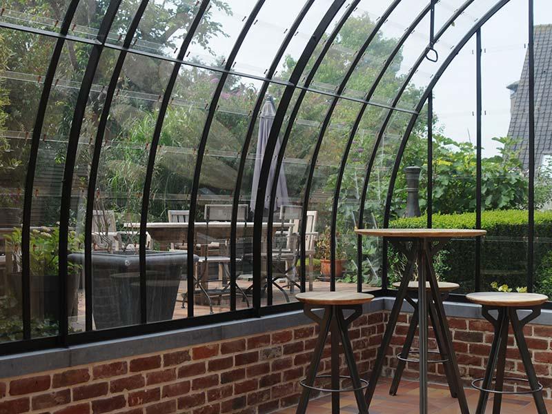 veranda smeedijzer gebogen dak op gemetseld muurtje dbg classics