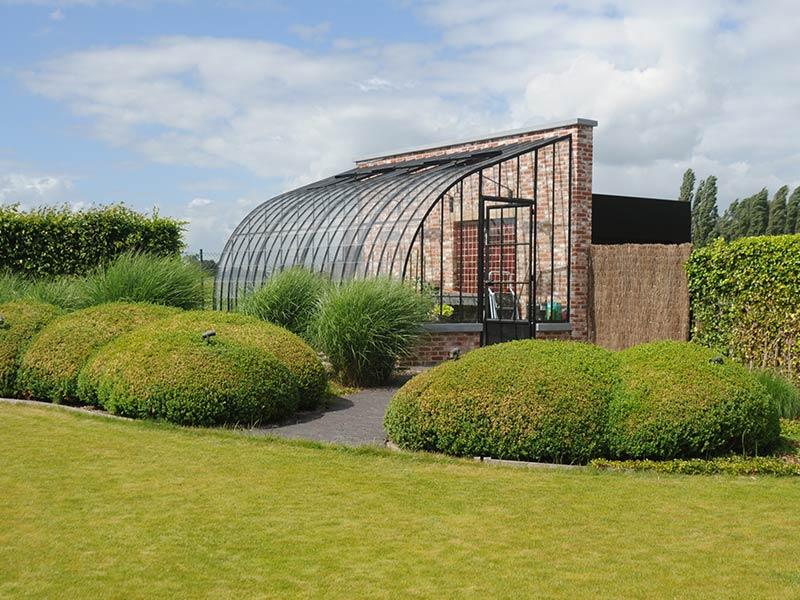 tuinserre kopen boogmodel in smeedijzer glas aangebouwd tegen muur dbg classics