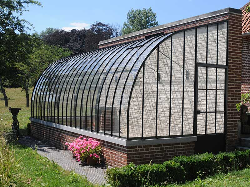 lean to greenhouse kit against wall in garden with curved roof dbg classics