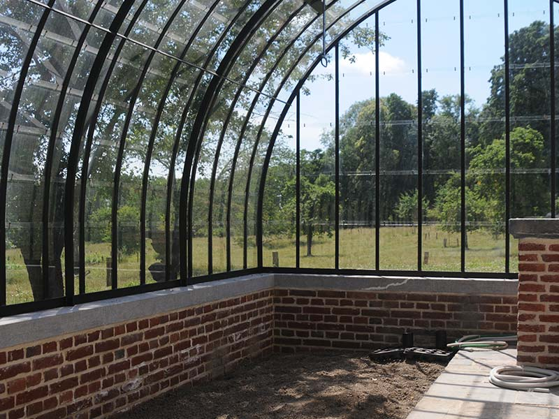 lean to greenhouse kit to grow vegetables and fruits in beautiful setting