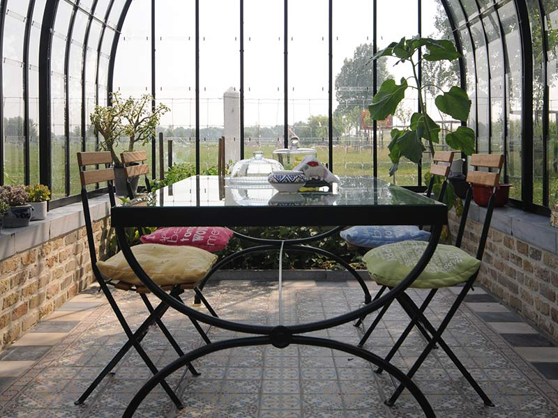 Victorian greenhouse suitable as veranda surrounded by nature dbg classics