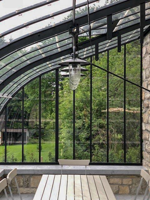 custom-made veranda with rustic interior and accompanying lighting by dbg classics
