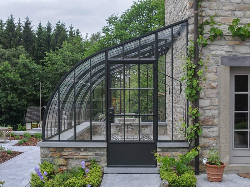 rustic veranda black wrought iron and glass against sidewall