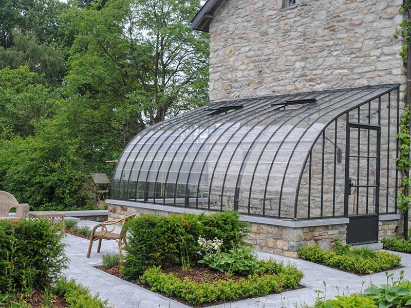 wrought iron veranda against sidewall with curved roof