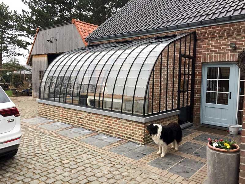 veranda orangerie attenante en verre et fer forge toit incurve dbg classics