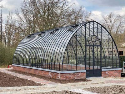 freestanding greenhouse in wrought iron and glass with lovely arched roof dbg classics