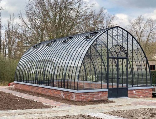 Freestanding greenhouse in glass & wrought iron for garden hobbyists