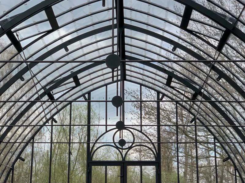 prachtig gebogen dak vrijstaande glazen tuinkamer sierlijke constructie dbg classics