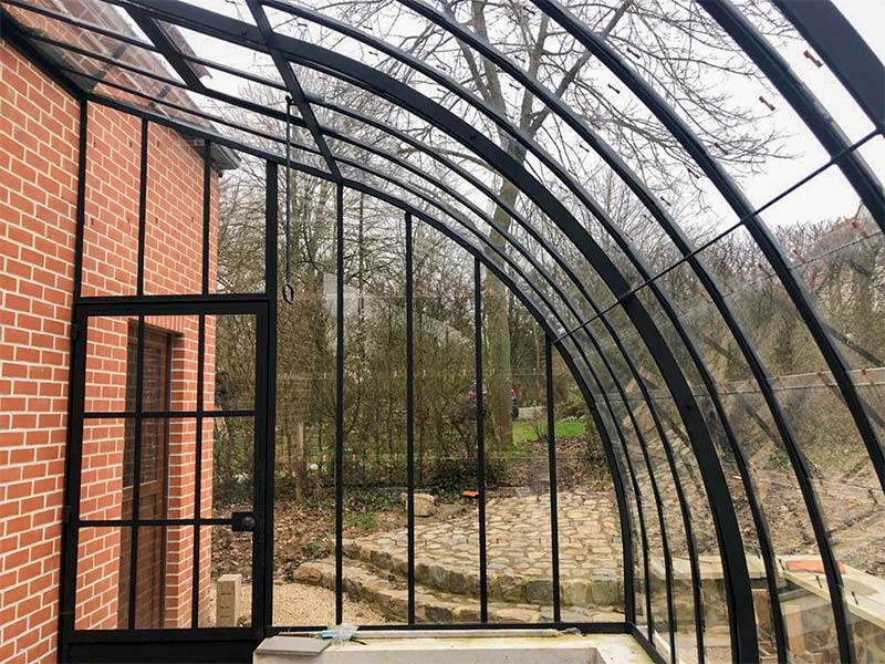 beautiful curving roof profiles which add extra touch to rustic greenhouse