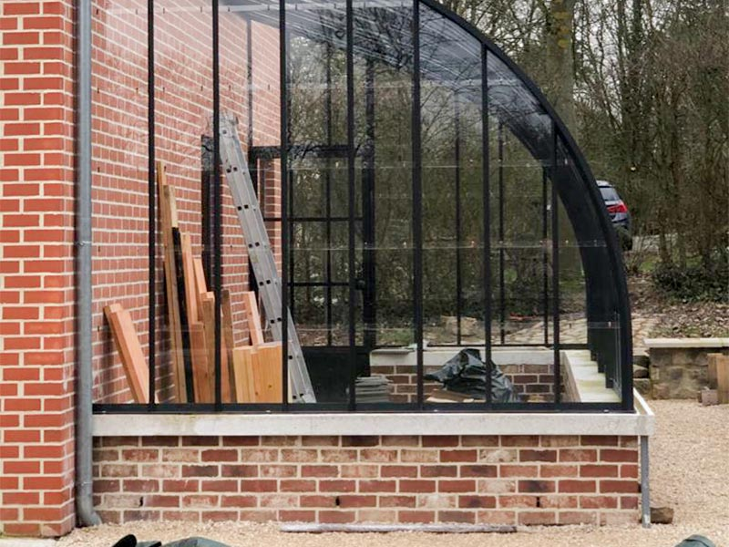 medium high dwarf brick wall as support for standing wrought iron profiles dbg classics