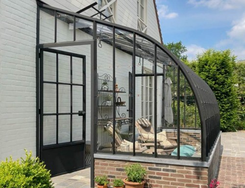 Elegant veranda with curved roof in wrought iron and glass | DBG Classics