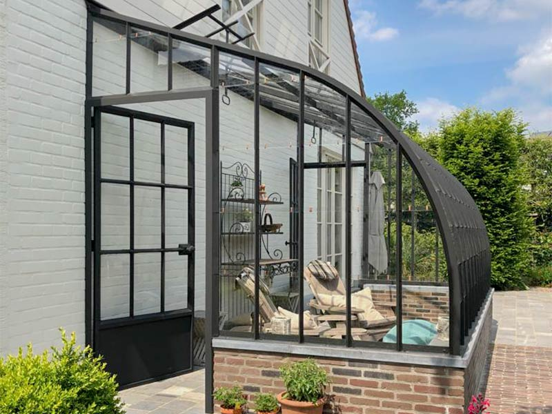 elegant veranda lean to model with curved roof in wrought iron dbg classics