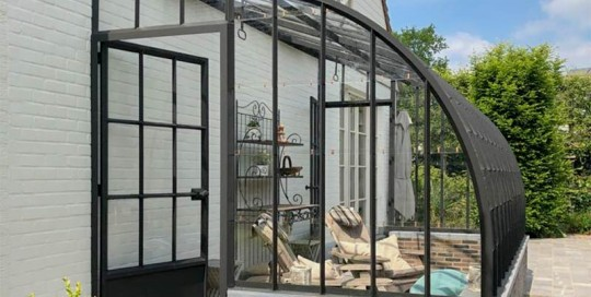 veranda elegante modele attenant avec le toit incurve en fer forge dbg classics