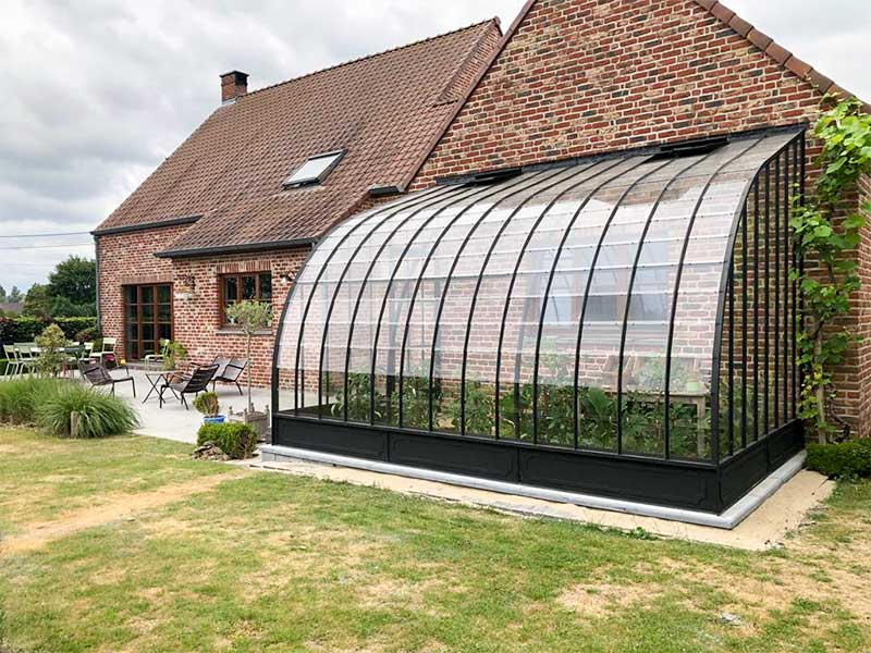 curved semi circular greenhouse against wall authentic vintage look