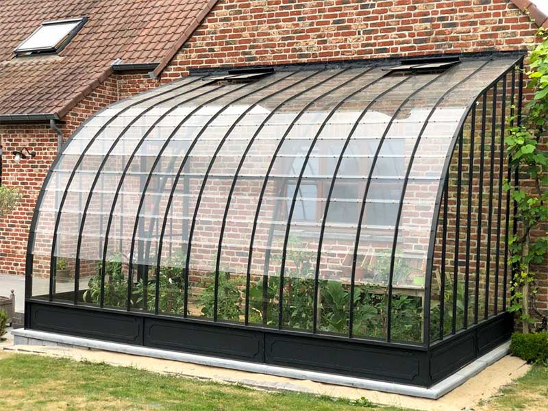 design greenhouse against facade in wrought iron and glass dbg classics