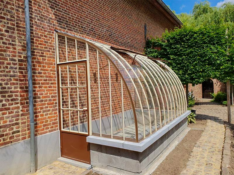half circle lean to greenhouse on dwarf wall with bluestone as finishing touch dbg classics