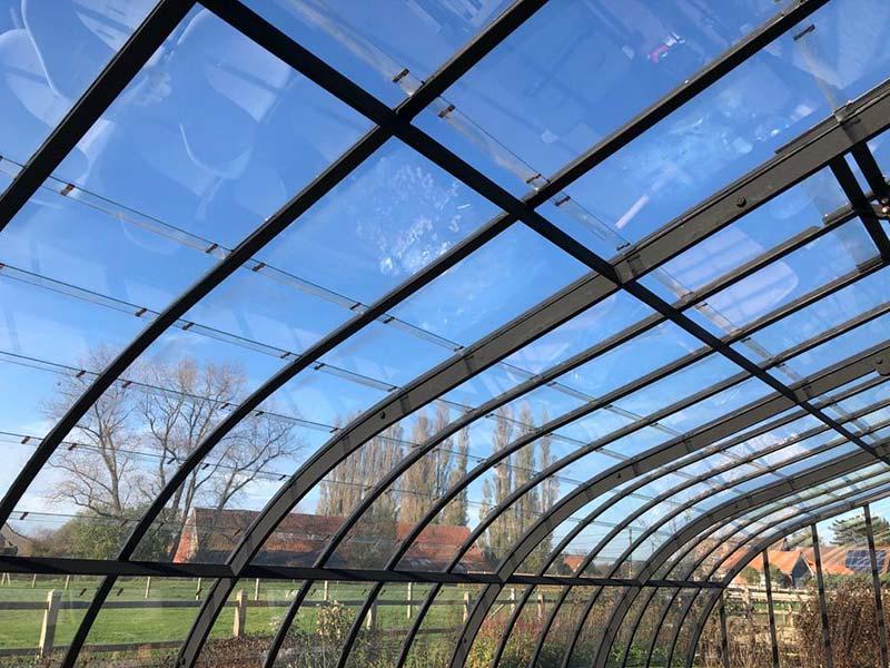 élégant toit ondulé serre de luxe modèle dextension profilés en fer forgé noir dbg classics