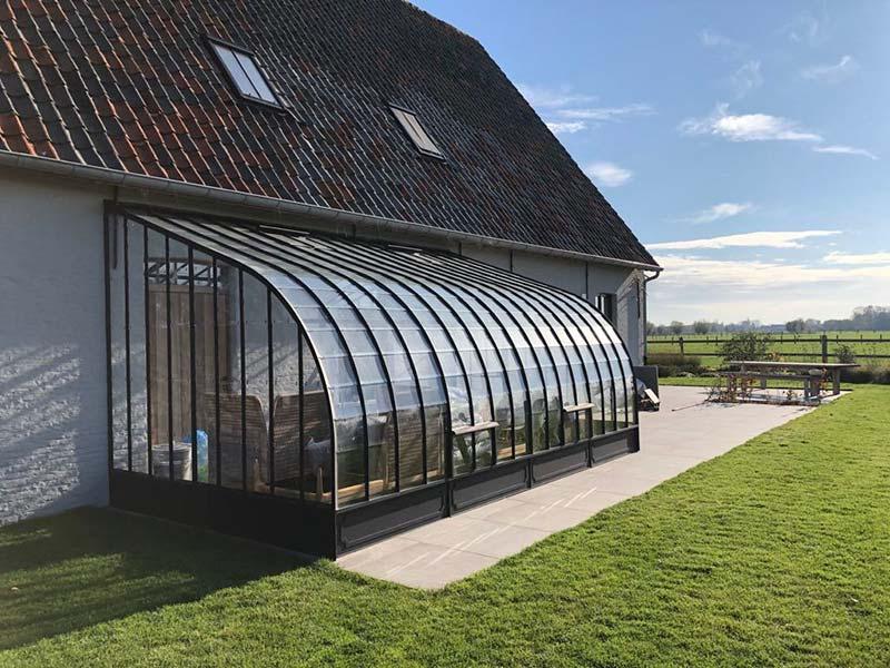 modèle dextension de véranda résidentielle en fer forgé et en verre avec espace de vie supplémentaire sur la terrasse dbg classics